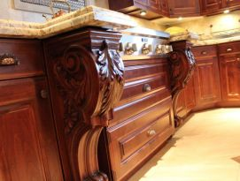 Large carved corbels surrounding cook top with drawers