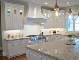 White kitchen with beautiful hood