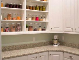 Pantry with white cabinetry and open shelving