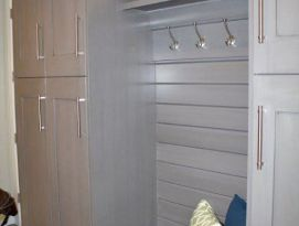Gray mud room lockers including bench seating with drawers below