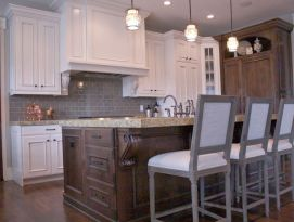 White cabinetry with natural wood island