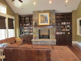 Built in book cases surround fire place