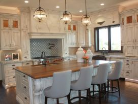 White kitchen with black walnut island counter top