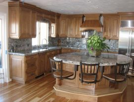 Natural wood kitchen with round island