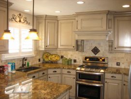 White kitchen cabinets with a great hood
