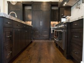 All wood kitchen with appliance panels on fridge