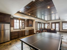 Game room kitchenette with ping pong table