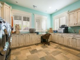 Large Laundry/Craft Room. White cabinetry with dark glaze and bright aqua walls.
