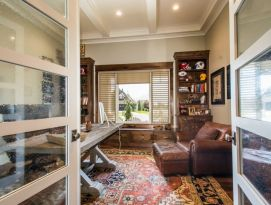 Home office with built in window bench and book cases