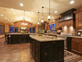 Expansive kitchen with wood and distressed black cabinetry