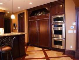 Wood fridge panels blend in with the kitchen cabinetry