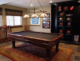Game room with floor to ceiling book shelfs