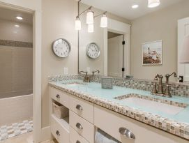 Jack & Jill Bath with glass and tile countertop