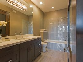 Bathroom with dark cabinetry and white countertops