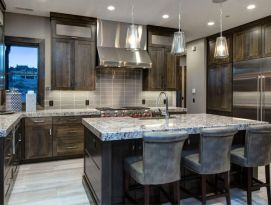 Gray quarter sawn oak kitchen cabinetry with granite counter tops