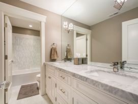 Spacious bathroom. White cabinetry with gray counter tops.