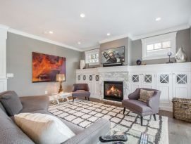 Gray and white living room with built-ins around the fireplace
