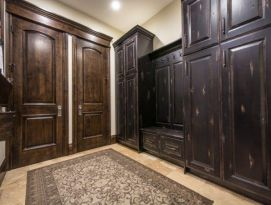 Mud room with distressed black lockers and bench seating with drawers below