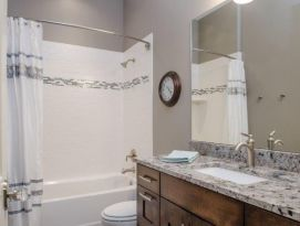 Bathroom in natural wood and grays