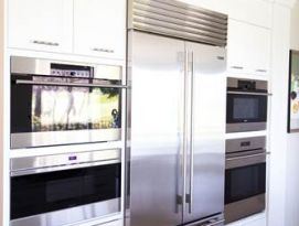 White cabinets with stainless appliances